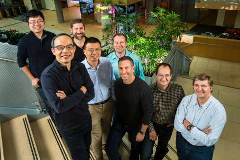 Microsoft researchers from the Speech & Dialog Research Group (from left): Wayne Xiong, Xuedong Huang, Geoffrey Zweig, Dong Yu, Frank Seide, Mike Seltzer, Jasha Droppo and Andreas Stolcke. Photo by Dan DeLong.