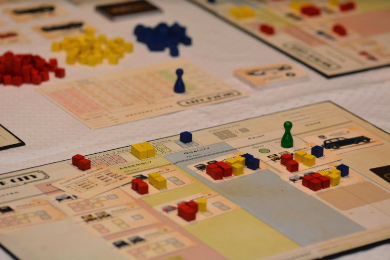 Motor City: a board game that teaches the principles of Kanban