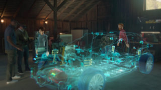engineers using Microsoft Mesh to view a holographic model of a car